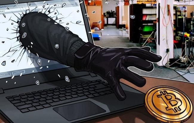 hand uit beeldscherm steelt crypto